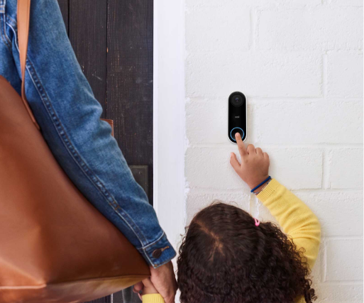 Child with mother ringing a nest doorbell