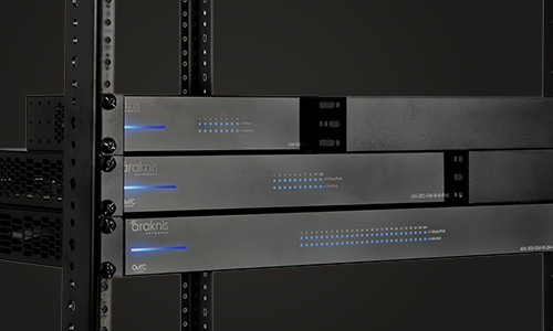 Stack of Araknis switches nested on a data rack