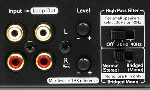 Zoomed-in view of Bridged or Stereo Output switch as as well as left and right gain controls on back of amp