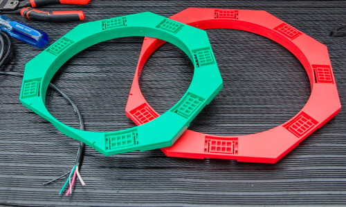Green and red brackets lying on ground