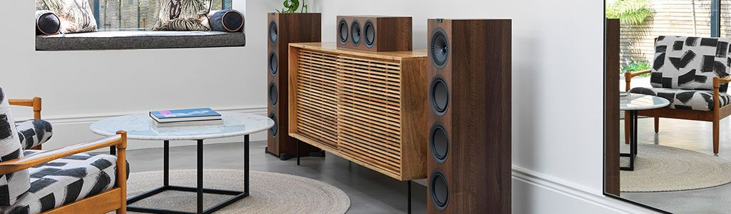 KEF Q950 floor speakers in the walnut color in a living room