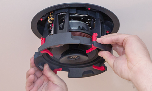 Dealer installing in-ceiling speaker